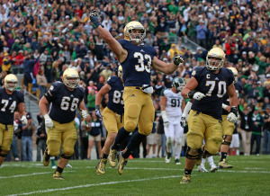 Cam McDaniel celebrates a touchdown against Michigan State.
