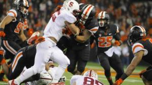 Tyler Gaffney powers through the Oregon State defense. Gaffney had 145 yards rushing and 3 TD in the game.