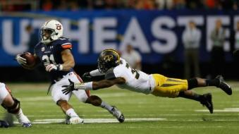 Tre Mason set SEC Championship Game records with 46 carries for 303 yards and 4 TD.