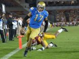 Brett Hundley runs into the end zone as he leads his UCLA Bruins past the USC Trojans.