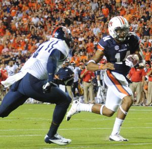 Auburn QB Nick Marshall passed for two scores and ran for two more as he kept his team in contention for the playoffs.