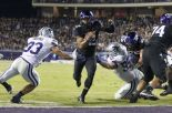 Trevone Boykin runs into the end zone for one of his 3 touchdown runs to lift TCU over Kansas State.
