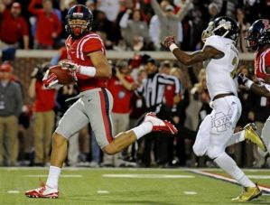 Ole Miss tight end Evan Engram gashed the Mississippi State secondary with 5 catches for 176 yards. Ole Miss upset the Bulldogs and knocked them out of contention for the playoffs.