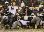 Navy QB Keenan Reynolds dives over from the 1 yard line to lead his team to their 13th straight win over Army.