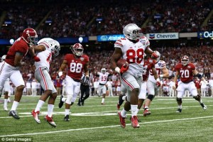 Ohio State defensive end Steve Miller returns an interception for a touchdown in the Buckeye's upset over Alabama